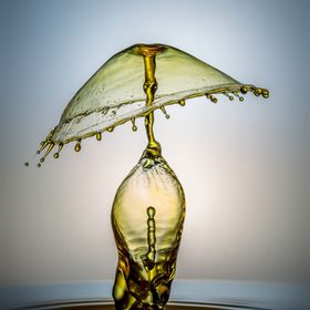the lamp is a fast shutter speed with speed light and few drops of water and 3 light set up.