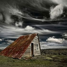 I like very much to take photos of abandoned things, like buildings, automobiles, boats and airplanes. this old summer house is very much photogr...