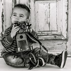 Little Devin with his camera
