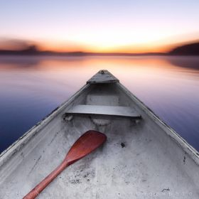 Using a tripod in the drifting canoe during sunrise, I exposed for 5 seconds (f22 needed!) as I lightly paddled to get a left to right motion.