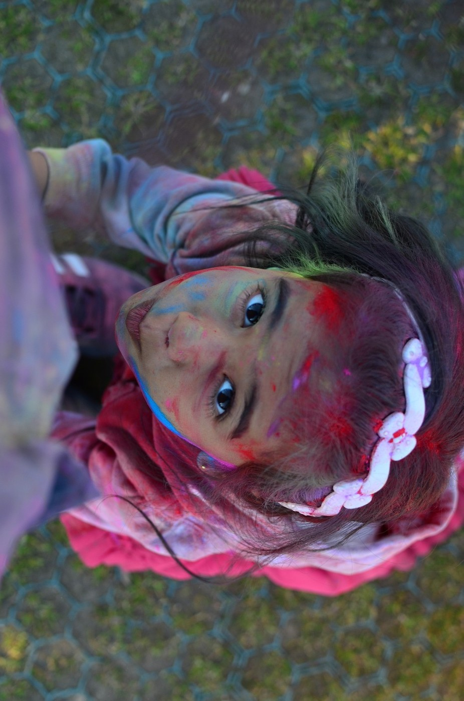 My liitle one holding me by my feet. We went playing \'Holi\'- festival of colours and she had such...
