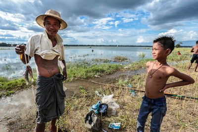 Burmese fisherman and boy