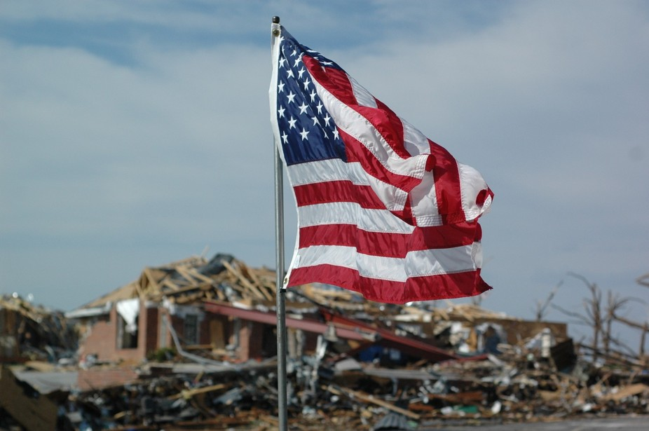 Flag placed by SAR teams in the yard of a home destroyed by the Joplin Tornado (2011).