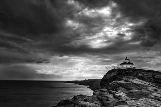 Drama at the Rock by nigel3333 - A Black And White World Photo Contest