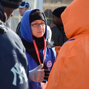 Member of FEMA Corps responding to homeowner inquiries in NYC after SuperStorm Sandy