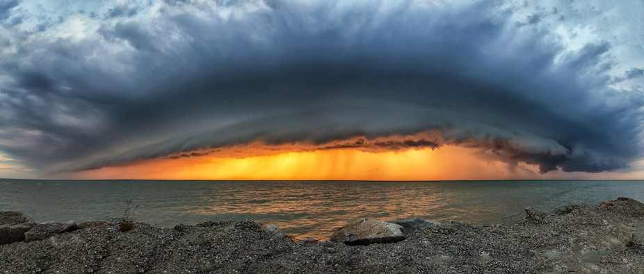 A strong thunderstorm approaches the shores of Point Clark, Ontario on a late summer evening.
