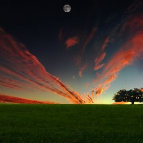 This is a composite of a number of pictures, and my attempt at creating what I can't seem to catch on location.  The sunset is a panorama of phot...