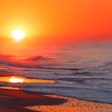 A spectacular sunrise in Oak Island, North Carolina.