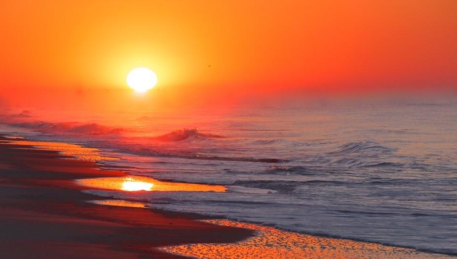 A spectacular sunrise in Oak Island, North Carolina.