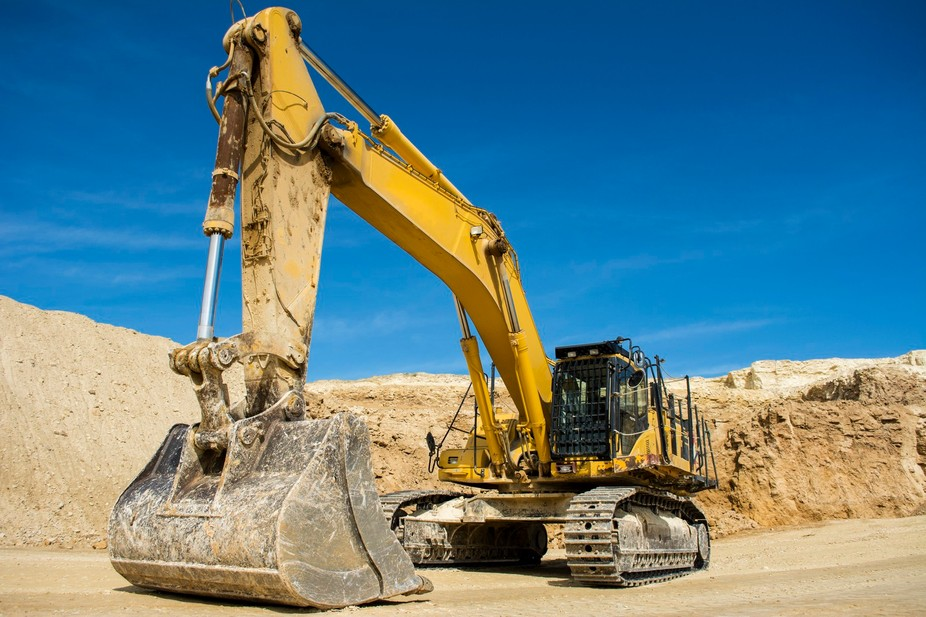Wide shot of a digger at a construction site