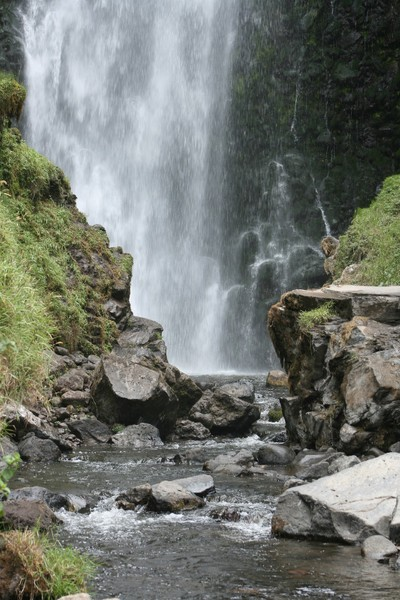 Peguche Falls framed by Rocks