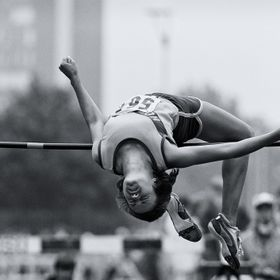 I used a Canon F-1 with a 400 2.8 lens for this shot of the high jumper.