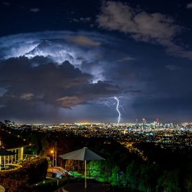 A large storm cell with dangerous lightning passes the city of Brisbane Australia.