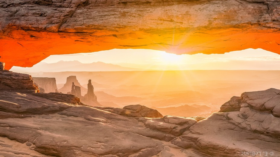 Sunrise on a dusty morning at Mesa Arch in Utah