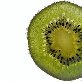 a slice of kiwi in a soda