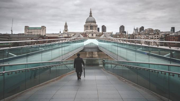 The Bowlerman Walking on Millennium Bridge. by byrnephotography - Rails and Fences Photo Contest