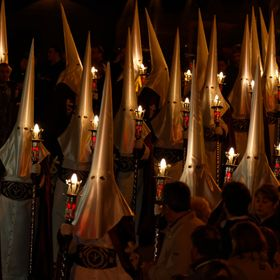 A group of 'Penitents' in an Easter procession in Cartagena, Spain, hiding their identities with the ancient 'Capirotes', the...
