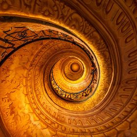 Ornate spiral staircase inside of Melk Abby, Austria