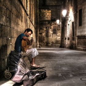 Taken during our stay in Barcelona June 2013. We found this guitarist by following his playing through the Gothic quarter in the early hours of t...