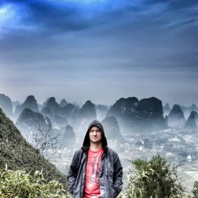 Alone as the early morning light made its impression over the unique topography surrounding Yangshuo (of Guangxi Zhuang Autonomous Region in Chin...