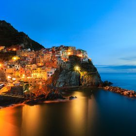Manarola is the oldest of the five villages in Cinque Terre on the Italian Riviera. This image was created right after sunset with a 238 second e...