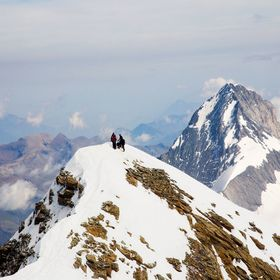 Climbers reaching the summit of the Jungfrau with the North Face of the Eiger behind them.  Switzerland