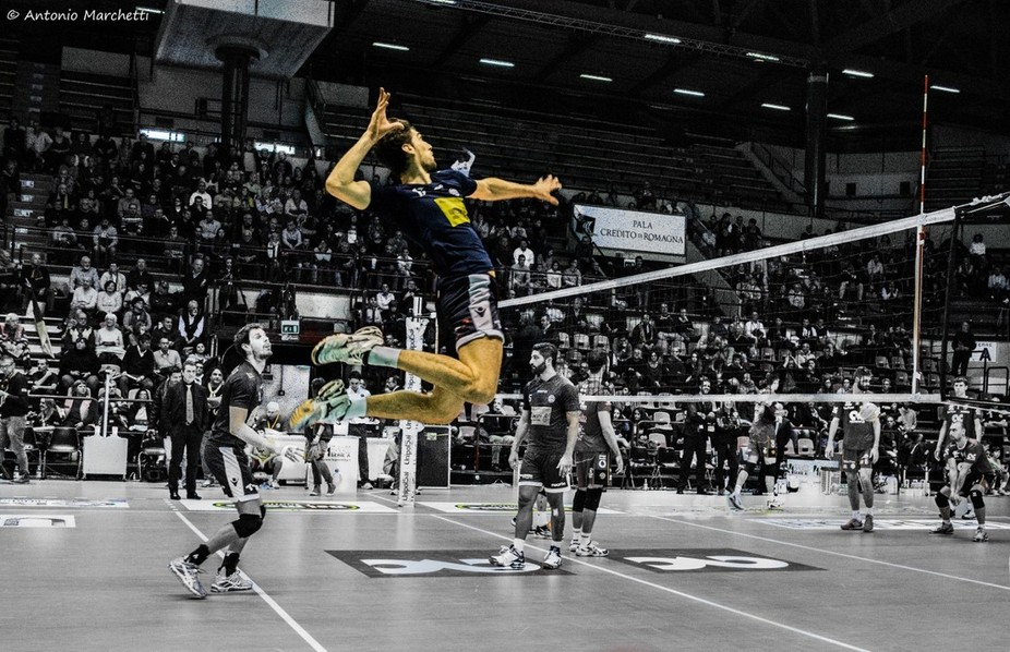 Luca Vettori, national italian volleyball player (Modena Volley) , warming up before the match against CMC Ravenna, played in Forlì , 30.11.2014.  Another attempt to make the subject shine in colours against a Black and White background.