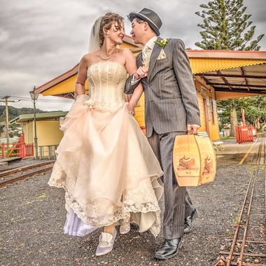 Thames miniature railway provides a wonderful backdrop for this vintage wedding couple.