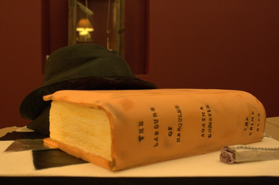 A cake styled to look like a book and hat