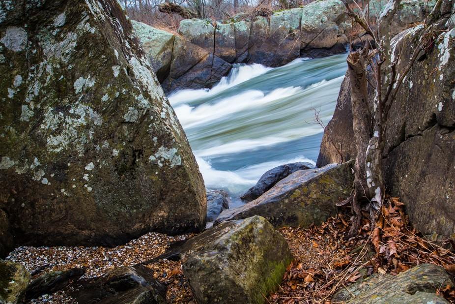 Potomac River at Great Falls, Maryland, rushing past rocks and shells, and remnants of Autumn
