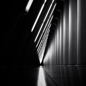 Illuminated neo-futuristic halway in B&W.