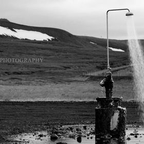 natural geothermal outdoor shower in the middle of nowhere North Iceland at midnight