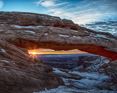 The glow of the Sunrise through Mesa Arch in Canyonlands National Park