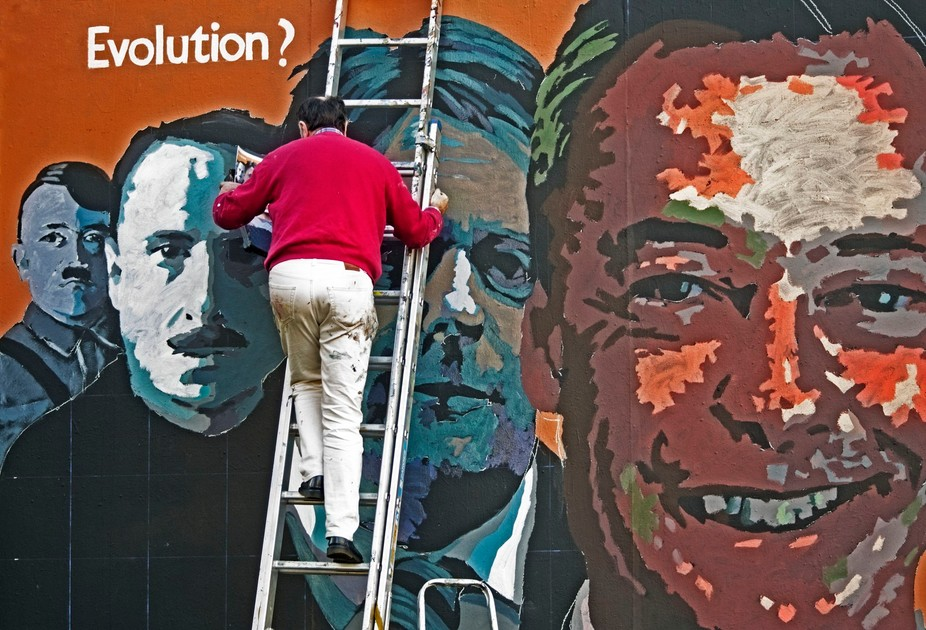 whilst in Edinburgh i came across this man painting on a billboard on the side of a church.its a ...