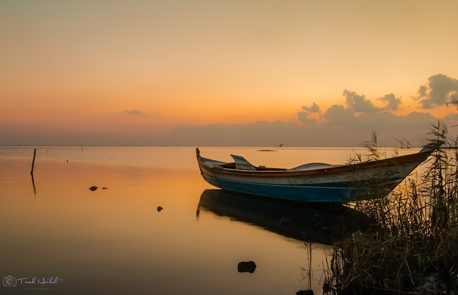 Lonely boat beside the dreamy lake