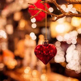 Christmas decoration hanging on a tree with Bokeh