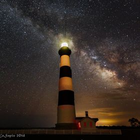 Bodie Island Lighthouse underneath the Milky Way on the Outer Banks of North Carolina. The lighthouse, stars, milky way, lightning bugs and even ...