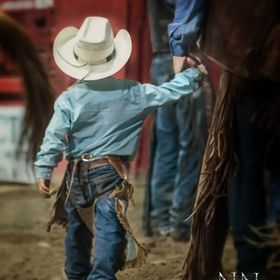 I made this image of a young cowboy holding his daddy's hand last year at the local rodeo. I just love little
