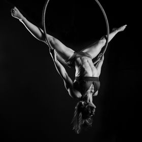Wendy Lindquist, a local fitness and bodybuilding trainer and dancer performing strength moves on an aerial hoop.   Even though I was there shoot...