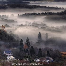 A mist-shrouded early morning view of Aberfoyle, from the Dukes Pass in the Scottish Trossachs.