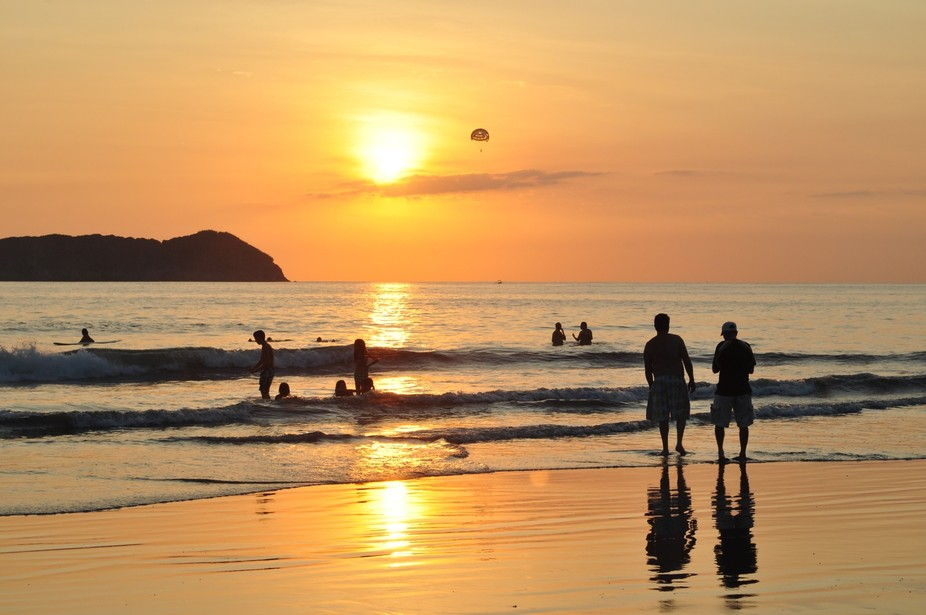 It was a stunning sunset on Manuel Antonio beach in Costa Rica and the paraglider silhouetted against the sun provided a parallel focal point.
