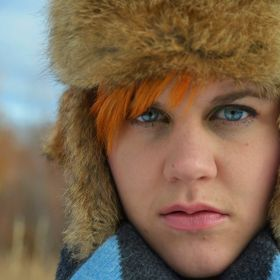 My best friend, Ashley, in her winter high fashion. Orange hat, with matching hair, reflecting the beautiful mid winter colors of Montana in the ...