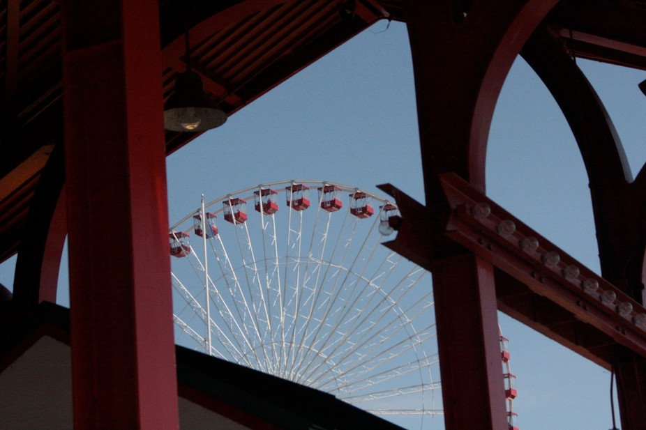 View  of the farris at Chicago\'s Navy Pier from under a covered bench.