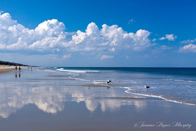 Cloud Reflections on the Beach