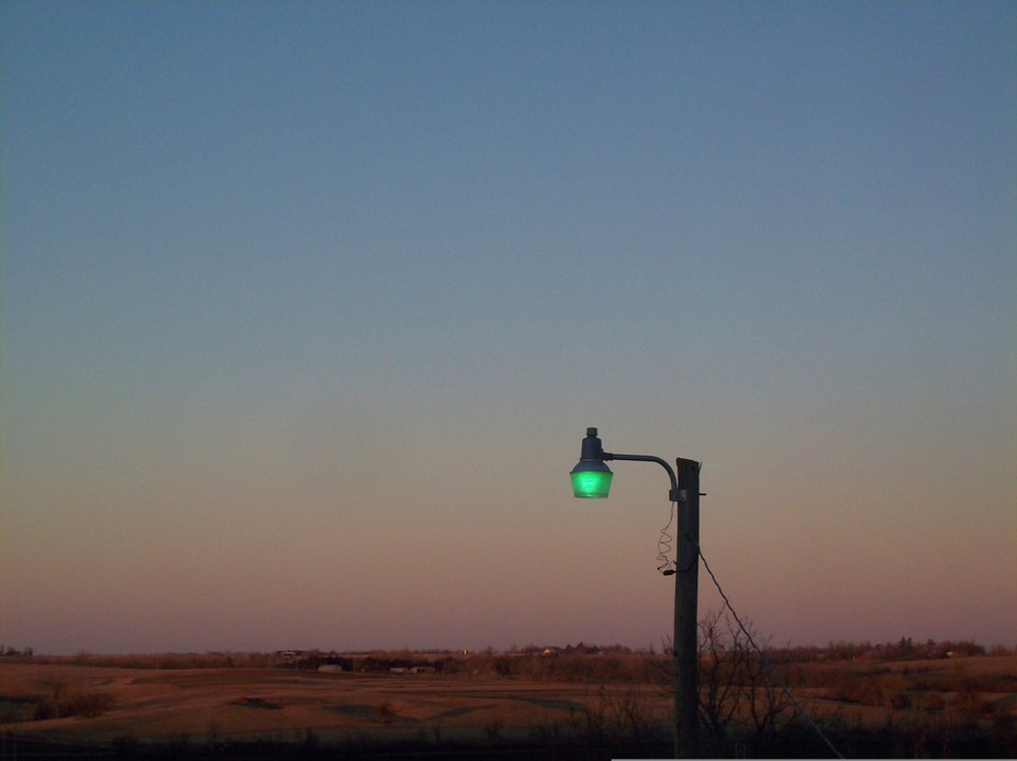 THis green light is unusual I do believe. And it with it against the setting sun light. Such a co...