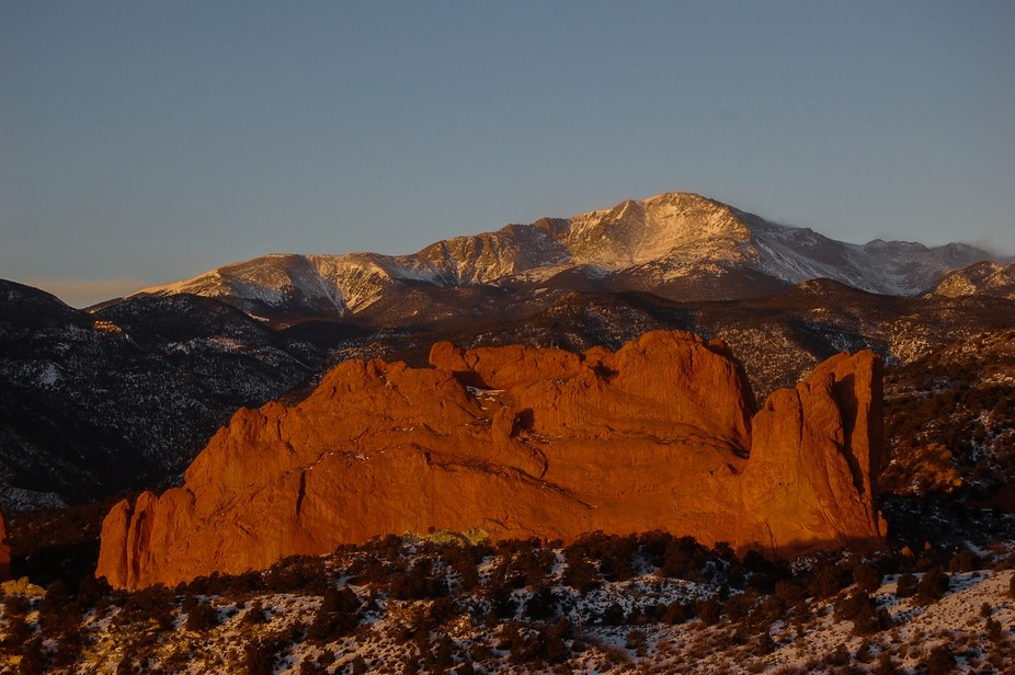 The Kissing Camels at the Garden of the Gods in front of Pikes Peak at sunrise. It was declared a...