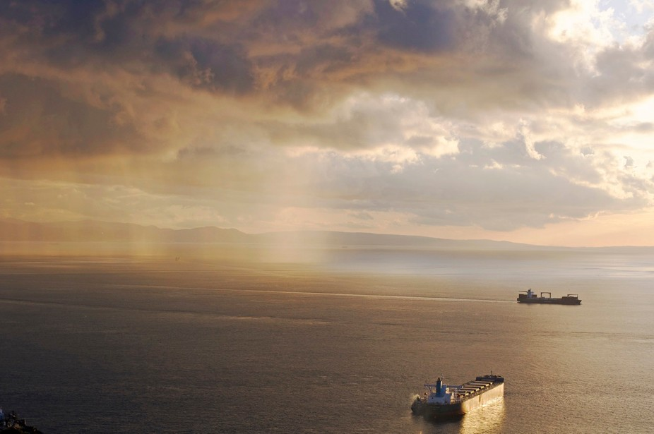Photo taken in Gibraltar at the Mediterranean steps, looking out towards Morocco, with the beauti...