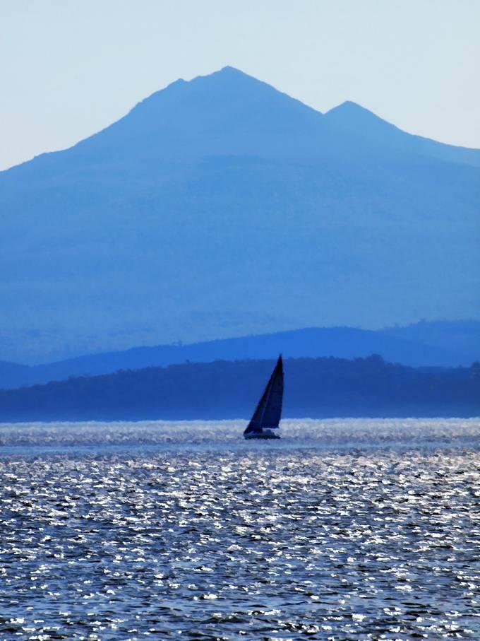 Sail boat on hot sunny day.