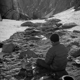My friend Dave, takes a moment of solitude and appreciation as we eat breakfast and prepare for the last leg of our ascent to the summit of Mount...