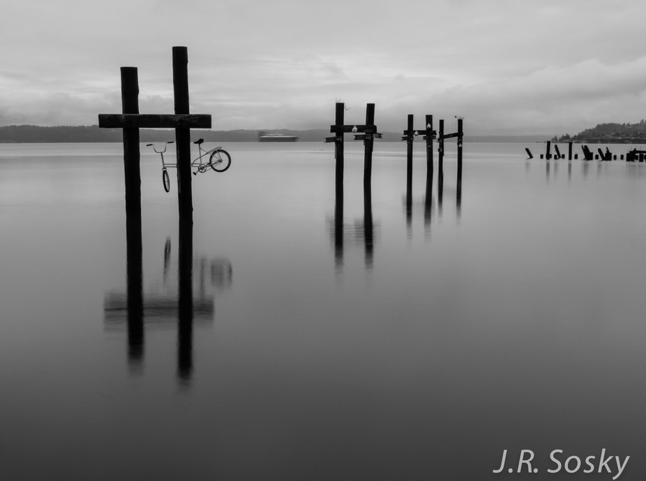 A set of old wharf pilings and one mysterious bike along Ruston Way in Tacoma, WA.